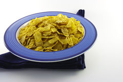 Cornflakes in a Blue Bowl Royalty Free Stock Image