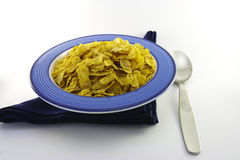 Cornflakes in a Blue Bowl with a Spoon Stock Images