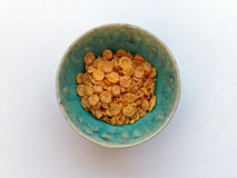 Cornflakes in Blue Celadon Bowl Royalty Free Stock Photography