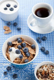 Cornflakes with blueberry and yogurt Stock Photos