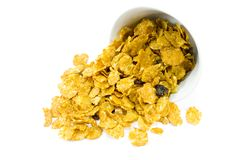 Cornflakes from bowl. Isolated over white Stock Photo