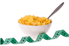 Cornflakes in bowl and measuring tape stock photos