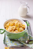Cornflakes in bowl on table Stock Photo