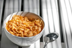 Cornflakes in the bowl on the table Royalty Free Stock Photo