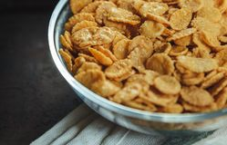 Cornflakes in bowl on the table with towel royalty free stock photography