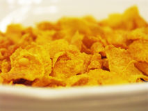 Cornflakes for breakfast. Macro of cornflakes in a bowl Stock Photo