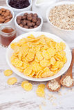 Cornflakes and breakfast cereals. Close-up, vertical Royalty Free Stock Photos