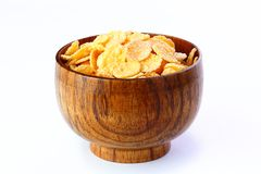 Cornflakes in ceramic bowl on table Stock Photos