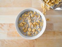 Cornflakes cereal breakfast from the bag to the bowl. royalty free stock photography