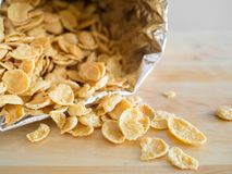 Cornflakes cereal breakfast from the bag to the bowl. stock photo