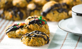 Cornflakes cereal cookies. With chocolate sauce and colorful sprinkles Stock Photography