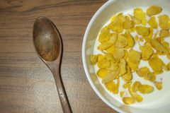 Cornflakes Cereal  with warm milk. In white bowl morning snacks Royalty Free Stock Image