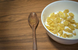 Cornflakes Cereal  with warm milk. In white bowl morning snacks Stock Photos