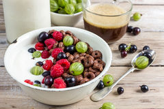Cornflakes cereals with berries. Orange juice and coffee for breakfast Stock Photo
