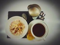 Cornflakes cereals milk tea lemon breakfast. Food fresh tasty healthy drink blackplate Stock Photos