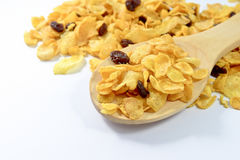 Cornflakes and currant in a wooden spoon. On white background Stock Photo