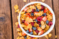 Cornflakes and different Berries. (Strawberries, Blueberries and fresh Raspberries Stock Photos
