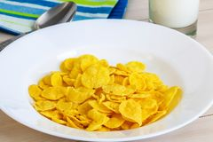 Cornflakes in dish before eating. In room Royalty Free Stock Images