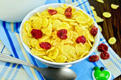 Cornflakes with dried cherries and milk on board Royalty Free Stock Photos