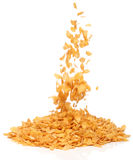 Cornflakes falling into a pile, Royalty Free Stock Images
