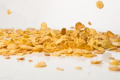Cornflakes falling into a pile Stock Photos