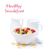 Cornflakes with fresh berries in a bowl and milk, isolated. On white, close-up Royalty Free Stock Photo