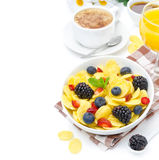 Cornflakes, fresh berries, cup of cappuccino and orange juice fo Royalty Free Stock Photo