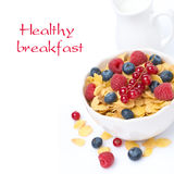Cornflakes with fresh berries and milk, isolated. Bowl of cornflakes with fresh berries and milk, isolated on white Royalty Free Stock Images