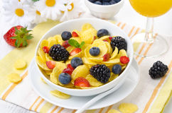 Cornflakes, fresh berries and orange juice for breakfast Stock Images