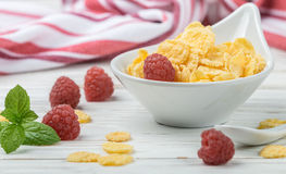 Cornflakes with fresh berries raspberry. In white bowl on the table. Healthy Breakfast. Selective focus. Top view Stock Photography