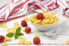 Cornflakes with fresh berries raspberry. In white bowl on the table. Healthy Breakfast. Selective focus. Top view Royalty Free Stock Image