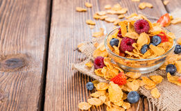 Cornflakes with fresh Berries. (Strawberries, Raspberries and Blueberries Stock Photo
