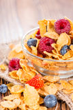 Cornflakes with fresh Berries. (Strawberries, Raspberries and Blueberries Stock Image