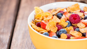 Cornflakes with fresh Berries. (Strawberries, Raspberries and Blueberries Royalty Free Stock Photos