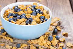 Cornflakes and fresh Blueberries. Cornflakes with some fresh Blueberries (close-up shot royalty free stock images