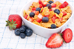 Cornflakes with fresh fruits on a tablecloth Royalty Free Stock Photo