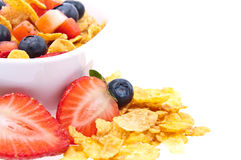 Cornflakes with fresh fruits on white Stock Images