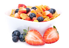 Cornflakes with fresh fruits on white Royalty Free Stock Image