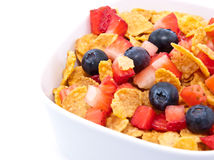 Cornflakes with fresh fruits on white Royalty Free Stock Images