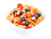 Cornflakes with fresh fruits on white Royalty Free Stock Photos