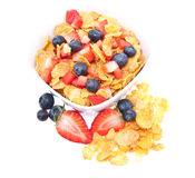 Cornflakes with fresh fruits on white Royalty Free Stock Photography