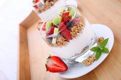 Cornflakes with fresh fruits and yogurt Stock Image