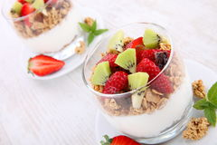 Cornflakes with fresh fruits and yogurt Royalty Free Stock Photo