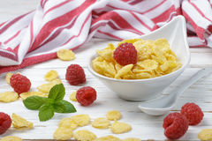 Cornflakes with fresh raspberries. Healthy Breakfast. Selective focus Royalty Free Stock Photos