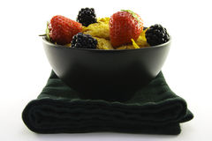 Cornflakes and Fruit in a Black Bowl Royalty Free Stock Image
