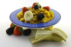 Cornflakes and Fruit in a Blue Bowl with Banana Stock Photos