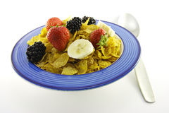 Cornflakes and Fruit in a Blue Bowl with Spoon Royalty Free Stock Photography