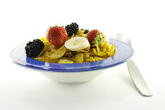 Cornflakes and Fruit in a Blue Bowl with Spoon Royalty Free Stock Photo