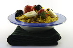 Cornflakes and Fruit in a Bowl with Napkin Royalty Free Stock Photos