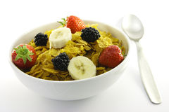 Cornflakes and Fruit in a White Bowl with Spoon Royalty Free Stock Photography